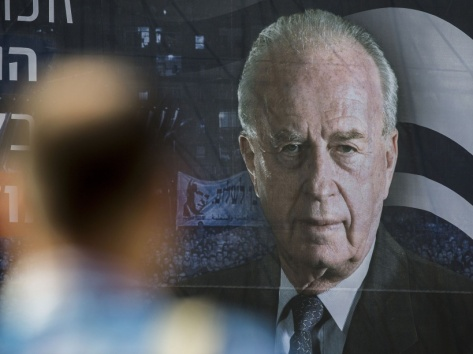 A man stands in front of a huge portrait of late Israeli prime minister Yitzhak Rabin, ahead of a memorial rally marking the 20th anniversary of Rabin's assassination in the Israeli city of Tel Aviv, on October 29, 2015. Rabin, who led the way in the effort towards peace between Israelis and Palestinians, was assassinated on November 4, 1995 during a peace rally in Tel Aviv by a Jewish rightwing extremist.
