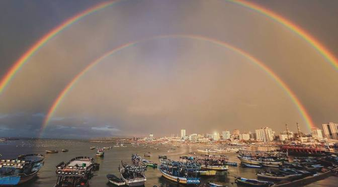 In the aftermath of heavy rain in Gaza, a double rainbow