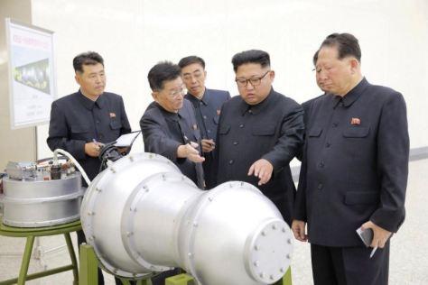 kim jong un examining bomb
